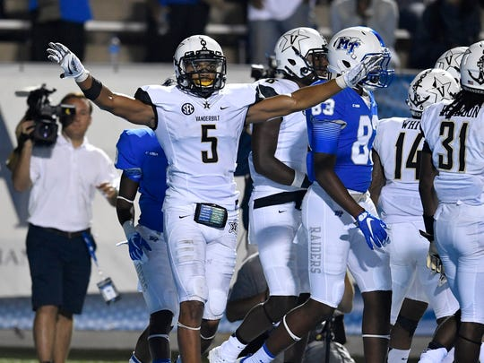 Vanderbilt safety LaDarius Wiley (5) celebrates after an MTSU play was ruled not to be a touchdown during the second half Sept. 2, 2017.