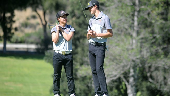 BJ Yde, left, and Tristan Gretzky, of Oaks Christian School, talk to each other at Sunset Hills Country Club in Thousand Oaks during a match against Thousand Oaks High.