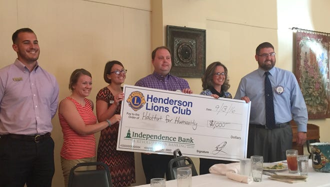 Representatives from agencies such as Habitat for Humanity, shown here, were among those receiving grants from the Henderson Lions Club Tuesday.
