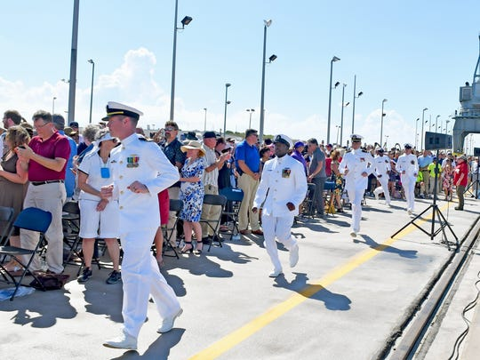The crew runs to the submarine. The USS Indiana (SSN 789), the newest Virginia-class attack submarine which is the most modern and sophisticated in the world, was commissioned on Saturday, Sept. 29 at the Navy port at Cape Canaveral Air Force Station. Over 5,000 people attended.