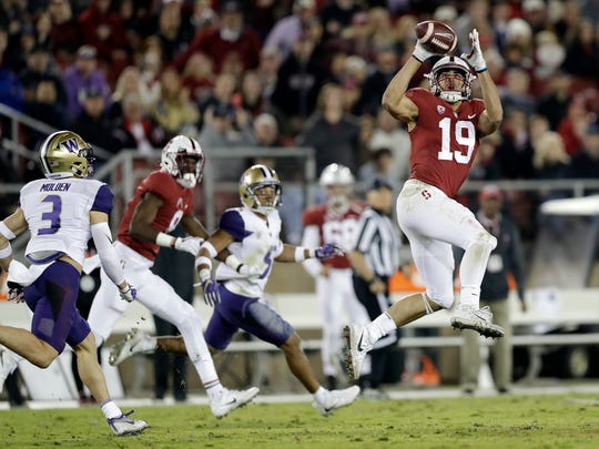 Stanford wide receiver J.J. Arcega-Whiteside (19) makes a catch in front of Washington defensive back Elijah Molden (3) during the first half of an NCAA college football game Friday, Nov. 10, 2017, in Stanford, Calif. (AP Photo/Marcio Jose Sanchez)