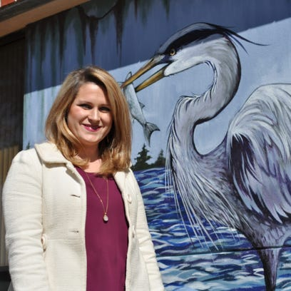 Leah Morace, a resident artist at River Oaks Square Arts Center, painted this new mural in downtown Alexandria. It will be finished later this month with mosaic tiles made by developmentally disabled students who attend classes at River Oaks.