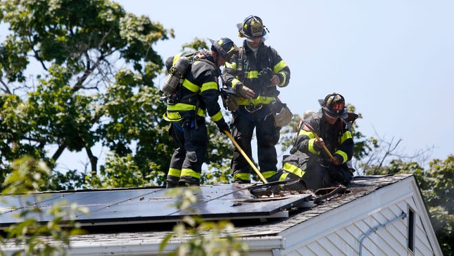 Firefighters respond to a house fire at 1 Sycamore Ave. in New Rochelle, July 21, 2016.