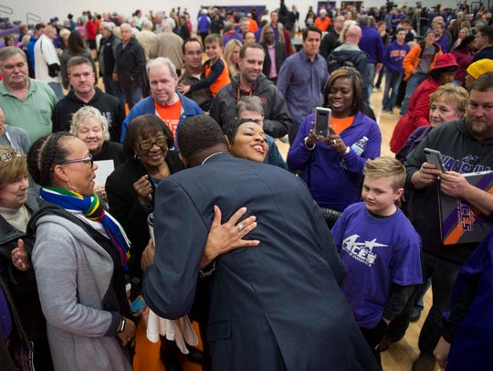 University of Evansville men's basketball head coach Walter McCarty greets fans and friends after being introduced at Meeks Family Fieldhouse on Friday, March 23.