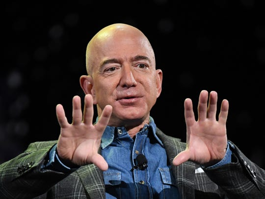 Jeff Bezos, the world's richest person, got billions richer in just minutes Thursday as Amazon shares soared in extended trading on news of a killer quarter driven by strong holiday sales.