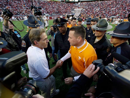 FILE - In this Oct. 26, 2013, file photo, Tennessee head coach Butch Jones, right, congratulates Alabama head coach Nick Saban after their NCAA college football game in Tuscaloosa, Ala.  Alabama has won all 10 meetings with Tennessee under coach Nick Saban, eight of them by double digits. (AP Photo/Dave Martin, File)