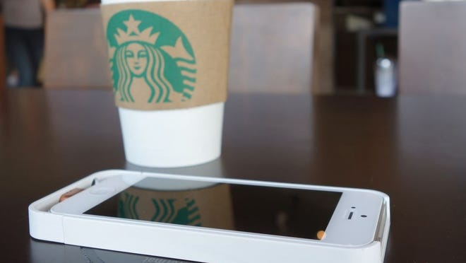 Starbucks new wireless Duracell Powermat charger at San Jose restaurant.