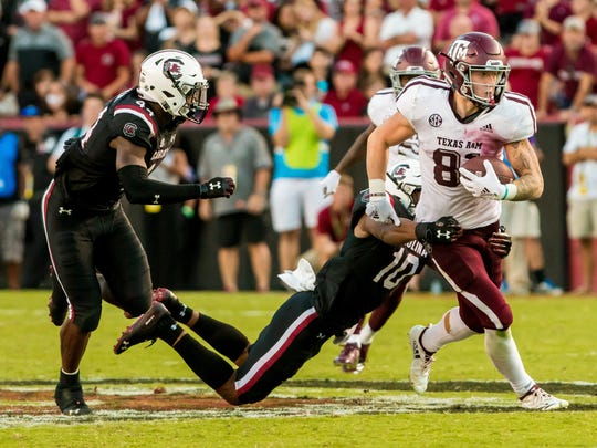 Oct 13, 2018; Columbia, SC, USA; Texas A&M Aggies tight end Jace Sternberger (81) breaks the tackle of South Carolina Gamecocks defensive back R.J. Roderick (10) in the second half at Williams-Brice Stadium. Mandatory Credit: Jeff Blake-USA TODAY Sports