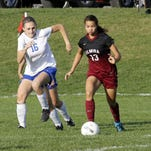Kendra Oldroyd of Elmira controls the ball as Emily Leland of Horseheads defends during the teams' 1-1 girls soccer tie at Horseheads during the regular season.