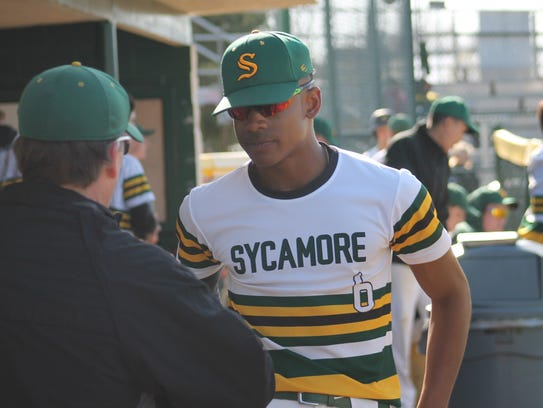 Lee May III listens to feedback from Sycamore coach