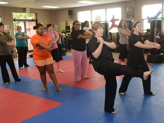 Carol Rousseau (front, left), senior master at Master Rousseau's Taekwondo, teaches a free self-defense class Saturday, May 9, 2015. The free class for women was held in honor of Mother's Day. Linzey Guillot (front, right), an instructor at Master Rousseau's Taekwondo, broughter her mother Victoria Guillot and grandmother Ruth Voorhies to the class.