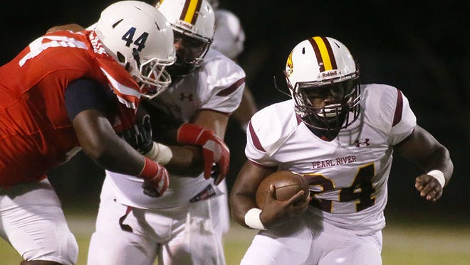 Pearl River running back Caleb Batie darts past an Itawamba defender during action last week at Fulton. Batie leads the Wildcats in rushing with 425 yards on 51 carries, and he's scored four touchdowns.