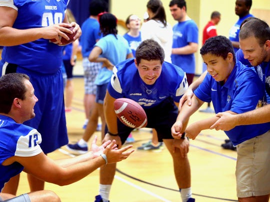 MTSU Blue Raider football players help out with Camp Ability.