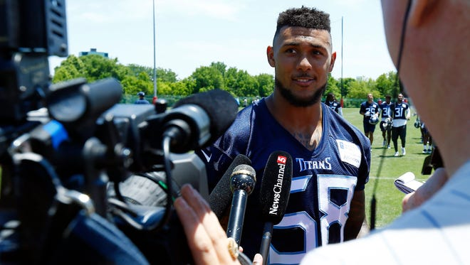 Titans linebacker Harold Landry talks with reporters after practice last week.