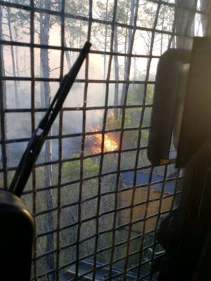The fire was about 10 acres off I-95 as of 8 p.m. Wednesday.