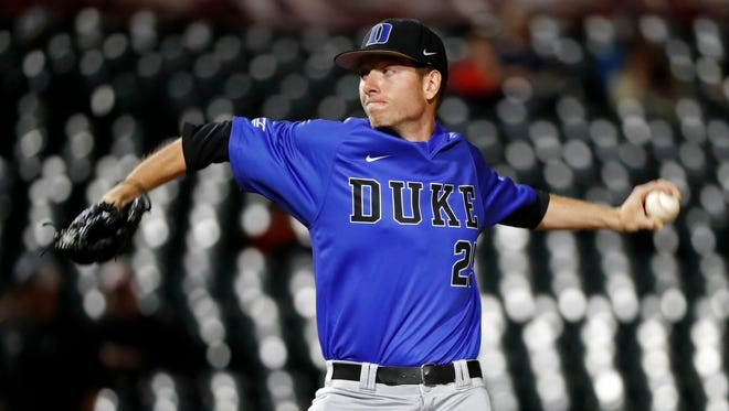 Duke pitcher Nick Hendrix (25) throws to a Clemson batter during game 3 of the 2017 ACC Baseball Tournament in Louisville, Ky., Tuesday, May 23, 2017. (Wade Payne/theACC.com via AP)