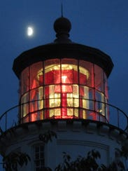 Umpqua Lighthouse at night with moon