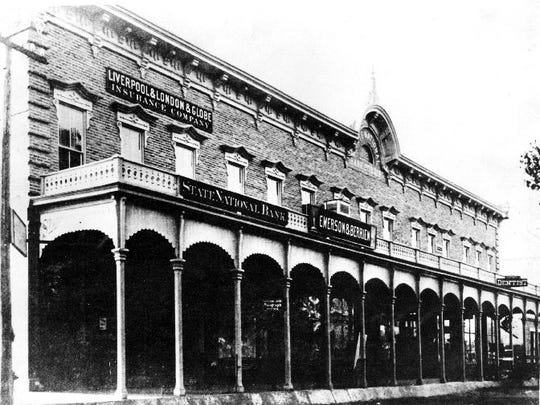 Circa 1883. Second location of the State National Bank of El Paso, Texas, on the southwest corner of East San Antonio and South El Paso Streets.