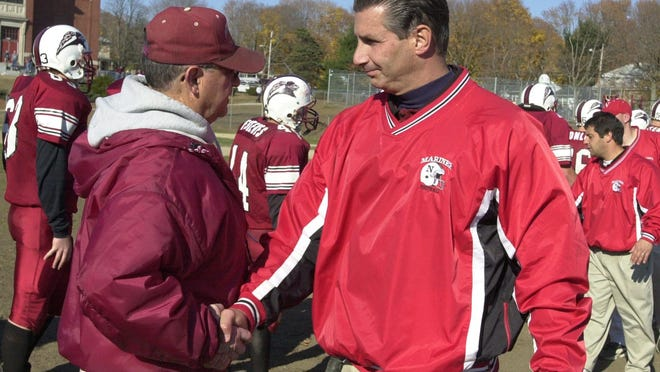 Dick Fossa, right, who died Saturday, served as head coach of the Narragansett High School football team for 15 seasons before becoming athletic director. He later moved to the same position at North Kingstown.