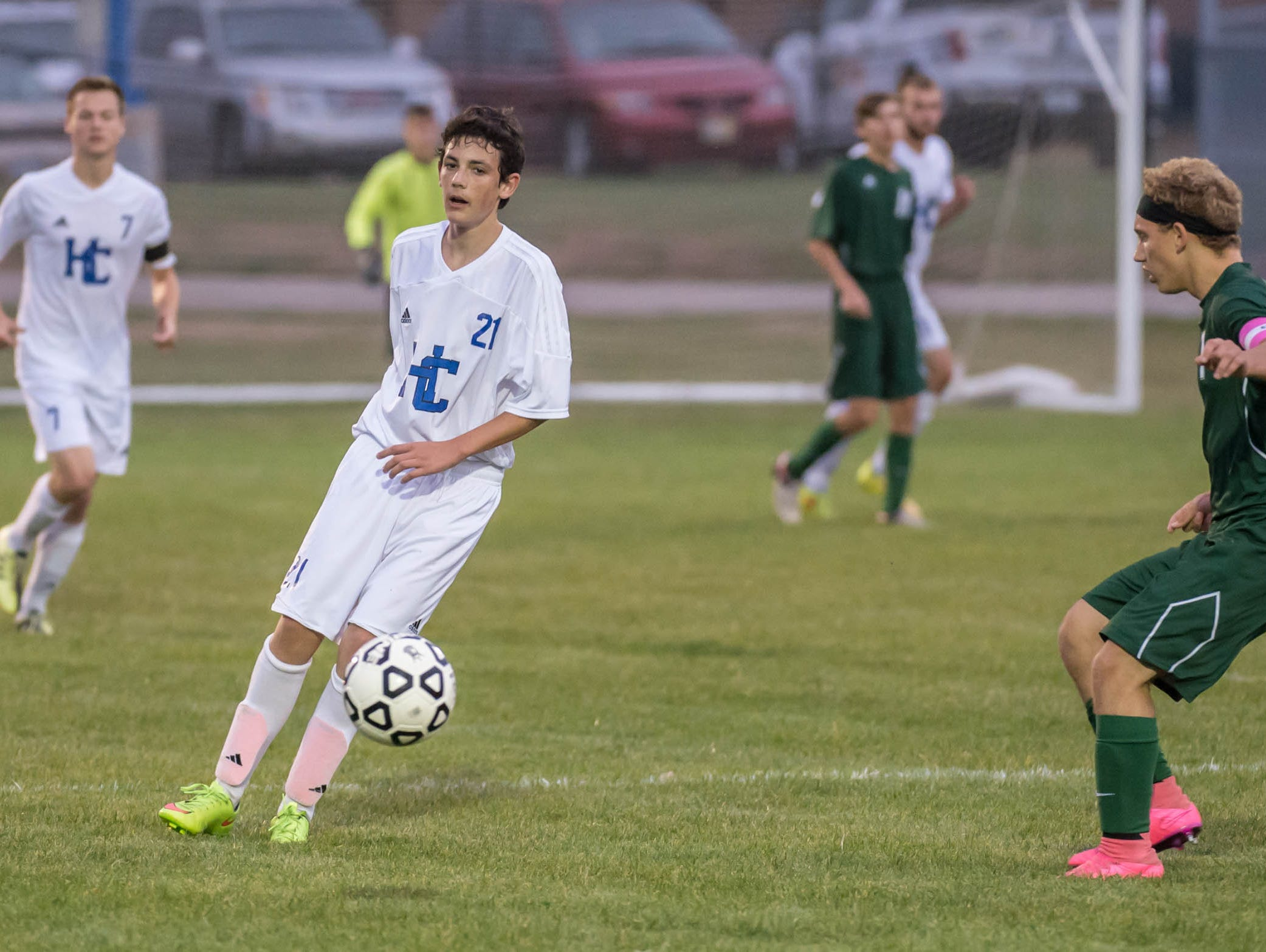 Harper Creek's Diego Subiza (21) advances the ball during district action Tuesday evening.