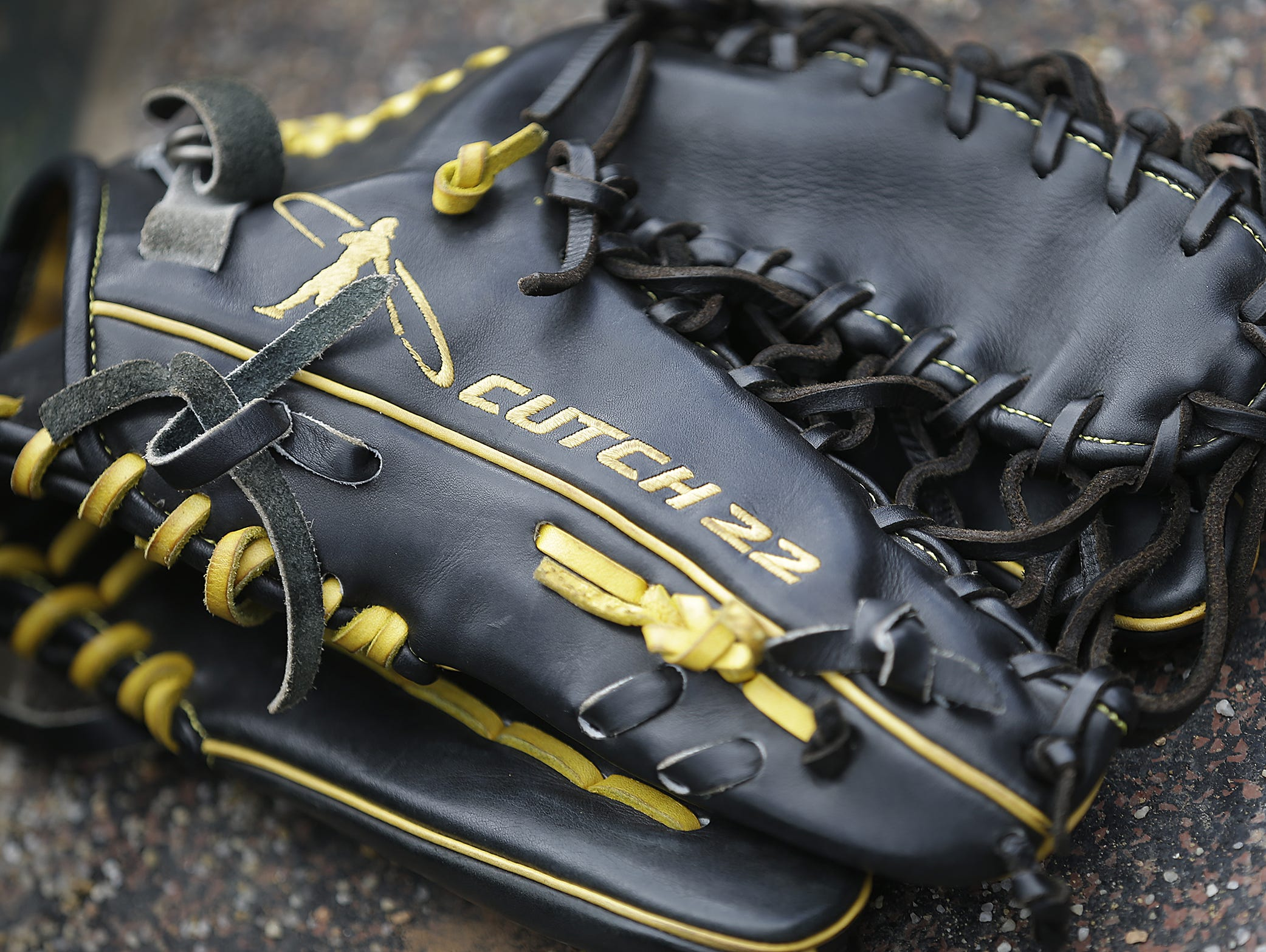The personalized glove of Pittsburgh Pirates center fielder Andrew McCutchen. The Pittsburgh Pirates hosted the Cincinnati Reds in an exhibition baseball game Saturday, Apr 2, 2016, afternoon at Victory Field.