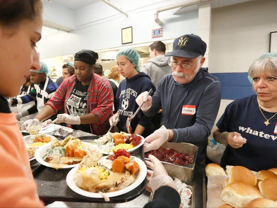 Jelisha Higgs, left, Kelsey Roa, Michael and Marlene Ulman plate food for guests during 2016 Eileen Hickey Thanksgiving Dinner at the Family Partnership Center in Poughkeepsie.