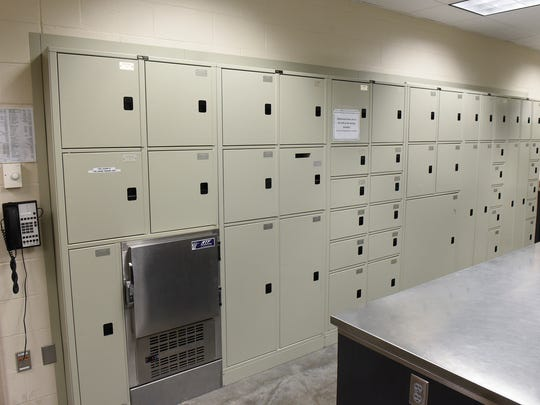 Pass-through lockers are used to move items into the lab areas at the St. Cloud Police Department.