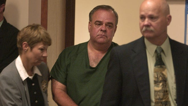 Gerald Carnahan is led into the courtroom for his arraignment in the murder of Jackie Johns in 1985