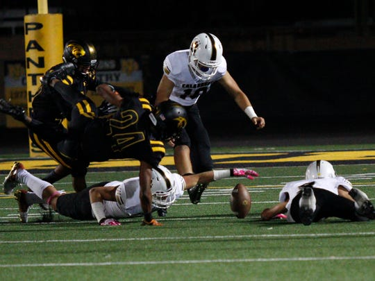 Calabasas and Newbury Park players go after a fumble during the first quarter of Friday night's game.