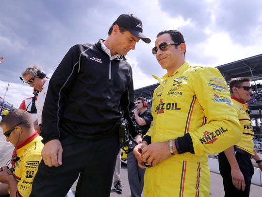 IndyCar driver Helio Castroneves (3) and Team Penske