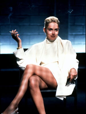 "Sharon Stone in the classic scene from 1992's ""Basic Instinct."" Stone said fame ""made my life so much more isolated and made me incredibly introverted."""