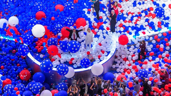 Democratic presidential nominee Hillary Clinton and her running mate Democratic vice presidential nominee Sen. Tim Kaine, D-Va., stand in a sea of balloons at the conclusion of the Democratic National Convention in Philadelphia , Friday, July 29, 2016. Photo/Mark J. Terrill