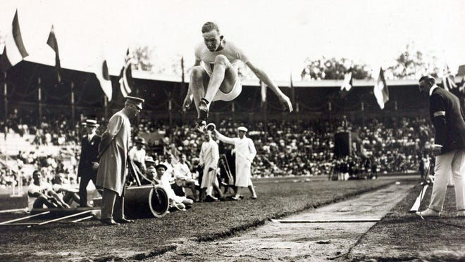 Albert Gutterson soars at the 1912 Olympic Games