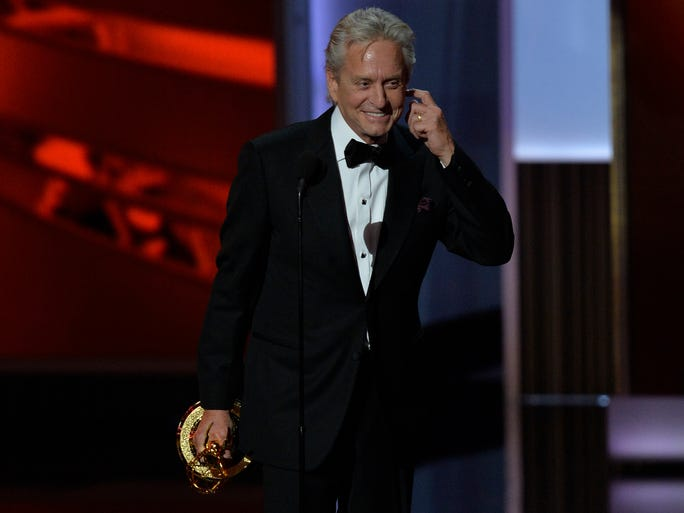 """Michael Douglas wins the Emmy for outstanding lead actor in a miniseries or movie for his portrayal of Liberace in 'Behind the Candelabra.' In a humorous acceptance speech, Douglas profusely thanked his on screen partner Matt Damon. He also thanked """"my wife, Catherine."""""""