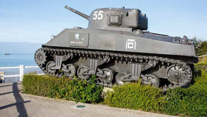 A Sherman tank stands guard over the D-Day landing beaches of Normandy