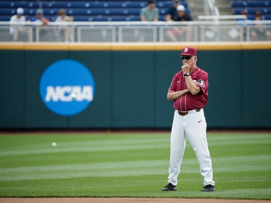 Florida State head coach Mike Martin watches his team practice for baseball's College World Series at TD Ameritrade Park, Friday, June 14, 2019, in Omaha, Neb. (Ryan Soderlin/Omaha World-Herald via AP)