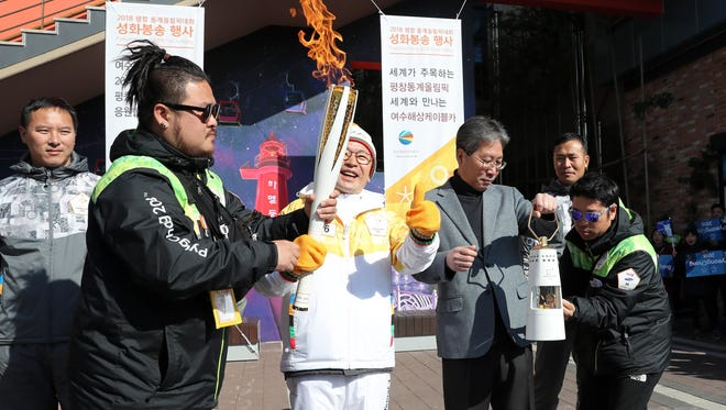 A ceremony takes place at a park in the southern port city of Yeosu, South Korea, on Nov. 19 2017, to mark the arrival of the 2018 PyeongChang Winter Olympics torch there as part of a nationwide relay.