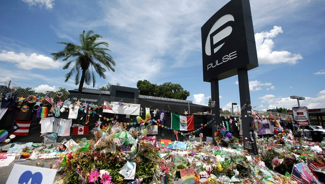 In this July 11, 2016, file photo, a makeshift memorial continues to grow outside the Pulse nightclub, the day before the one month anniversary of a mass shooting, in Orlando, Fla. Survivors and victims' relatives are marking the second anniversary of the Pulse nightclub shooting with a remembrance ceremony, a run, art exhibits and litigation.