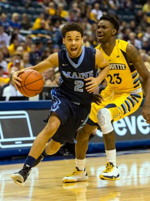 Maine guard Kevin Little, who is transferring to CSU, drives past Marquette defender Jajuan Johnson during a game last season. Little averaged 14.7 points a game for the Black Bears.