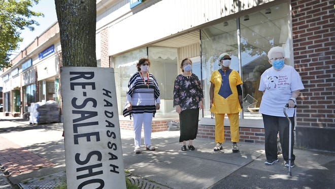 Hadassah Women members Kathy Belt, Marilyn Lubarsky, Regeline Montes and Gladys Petkun meet in front of the former Hadassah Re-Sale Shop in Quincy, which closed in May 2020 after 60 years due to the challenges of COVID-19.