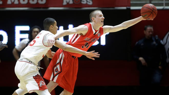 Ball State's Sean Sellers (34) reaches for the ball as Utah's forward Kyle Kuzma, left, defends during the second half of an NCAA college basketball game Friday, Nov. 14, 2014, in Salt Lake City. Utah won 90-72. (AP Photo/Rick Bowmer)