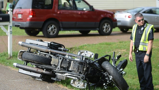 A motorcycle wrecked on Weatheridge drive Wednesday afternoon after attempting to avoid a car pulling into a driveway on the street according to officials.