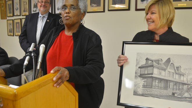Fanwood Board of Health member Kathleen Thomas, center, was honored as the borough's Volunteer of the Month by Mayor Colleen Mahr, right, and Councilman Tom Kranz, left, at a Fanwood Brough Council meeting in December,