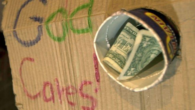 A panhandler sign.