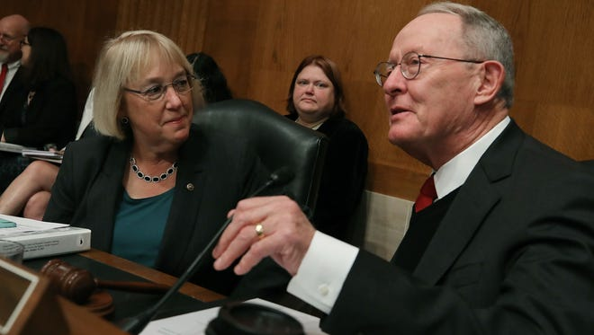 Sens. Lamar Alexander and Patty Murray confer during a Senate Health, Education, Labor and Pensions Committee hearing on Capitol Hill on Oct. 19, 2017.