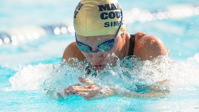 Martin County's Sloan Sizemore swims the breaststroke leg of the 200 yard medley relay Saturday, November 11, 2017, during the FHSAA Class 3A State swimming and diving finals at Sailfish Splash Water Park in Stuart. To see more photos, go to TCPalm.com. CQ: Sloan Sizemore