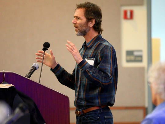 Ilan Levin talks to residents from Portland about the