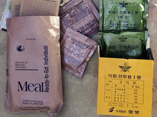 A U.S. MRE, left, and a Korean MRE, right are seen at the U.S. military base in Bagram, Afghanistan, in this Feb. 21, 2003 photo. While almost everyone breaks out similar-looking military MREs - plastic-wrapped, precooked Meals Ready-to-Eat - the contents of each packet reveal the cultural differences and national pride that is not always visible from a distance.