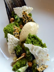 A hummus and tabbouleh dessert of black sesame paste, parsley mint cake, grilled pita gelato, chickpeas, sesame brittle, aquafaba meringue and cucumber by pastry chef Ben Robison of Ferndale's Local Kitchen and Bar.