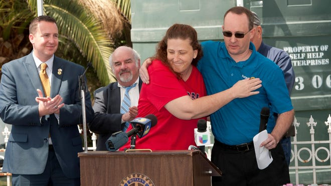 Patrick Isherwood, right, gets a hug from resident Janice Gearing as Cal Water and the local rotary clubs hold a ground breaking Thursday, April 28, 2016 on Avenue 322 east of Highway 63. The water project will bring water to 14 county residents in the area whose wells have run dry. Some have been without water for nearly two years. Isherwood is with Self-Help Enterprises.